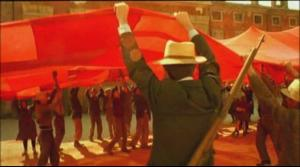 Workers raise their long hidden red banner